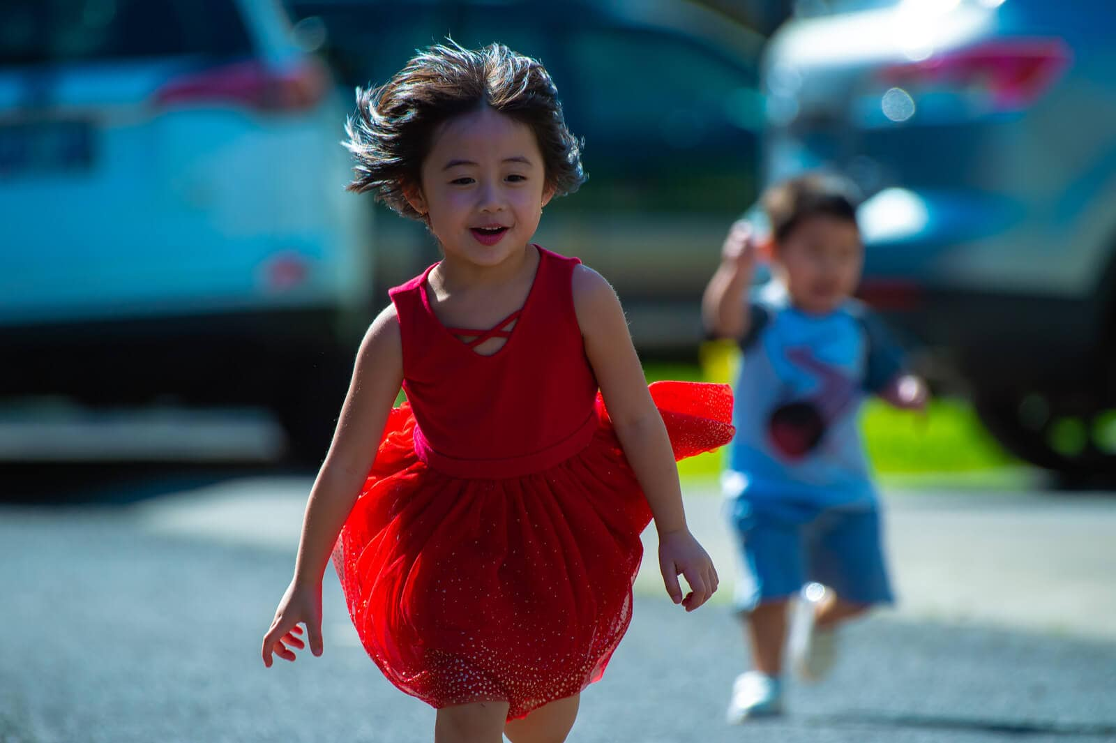 Canva - Photo of Girl in Red Dress Running on Street (1) (1)