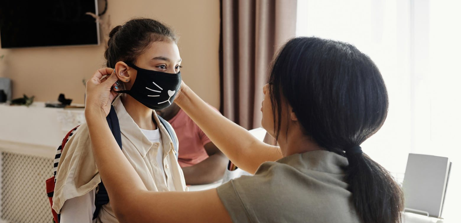 Canva - Mother Putting a Face Mask on her Daughter